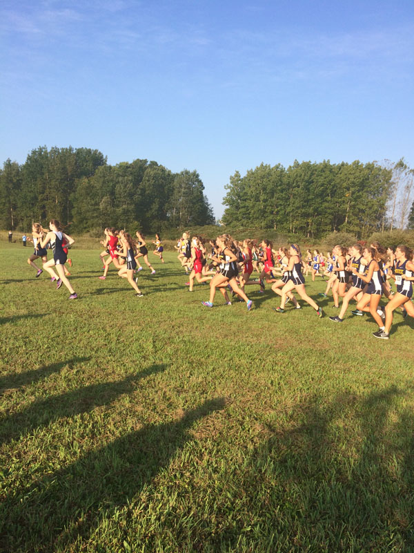Manistee Chippewas Boys and Girls Cross Country Team on course running