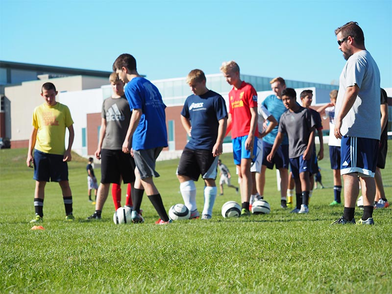 Manistee Chippewas Boys Soccer Team Photo on field at practice working on drills