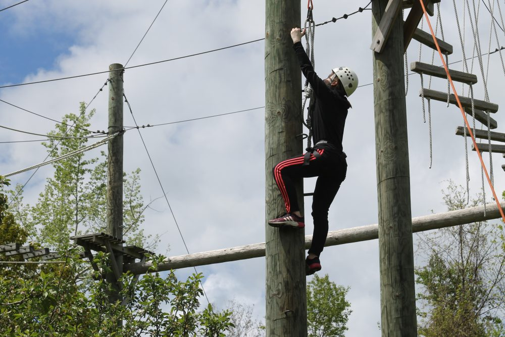 Student climbing at Adventure Learning