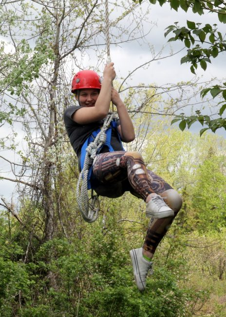 Student swinging on rope at Adventure Learning