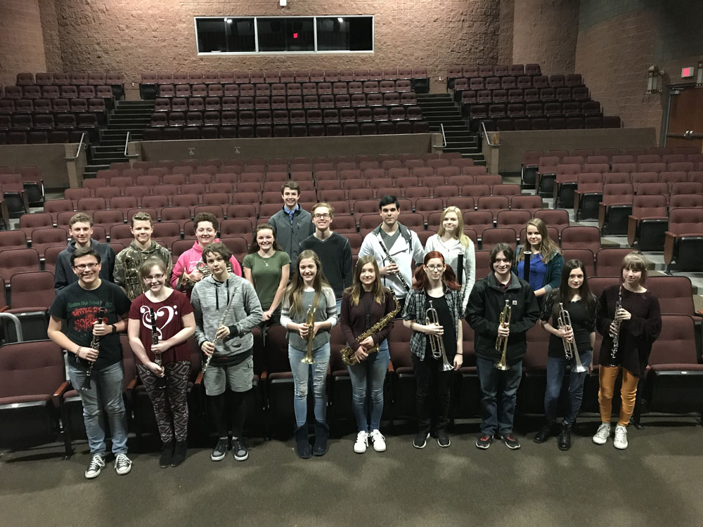 band students posing in auditorium