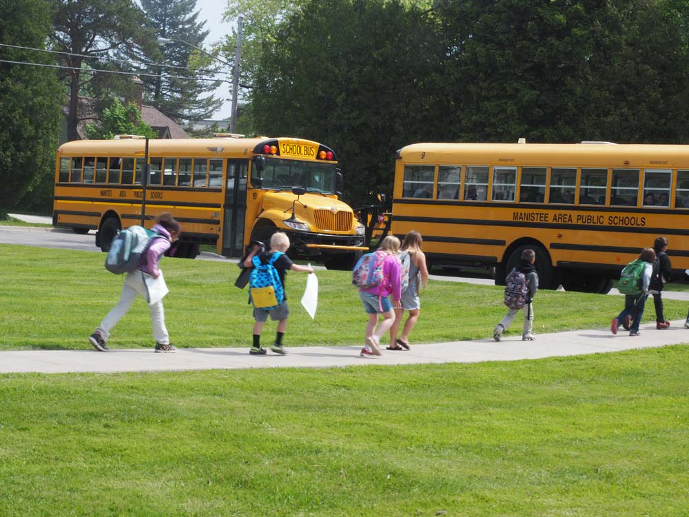 students getting on the bus at jefferson elementary
