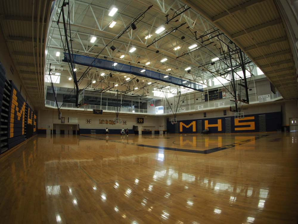 MMHS gym floor with a couple people playing in the distance