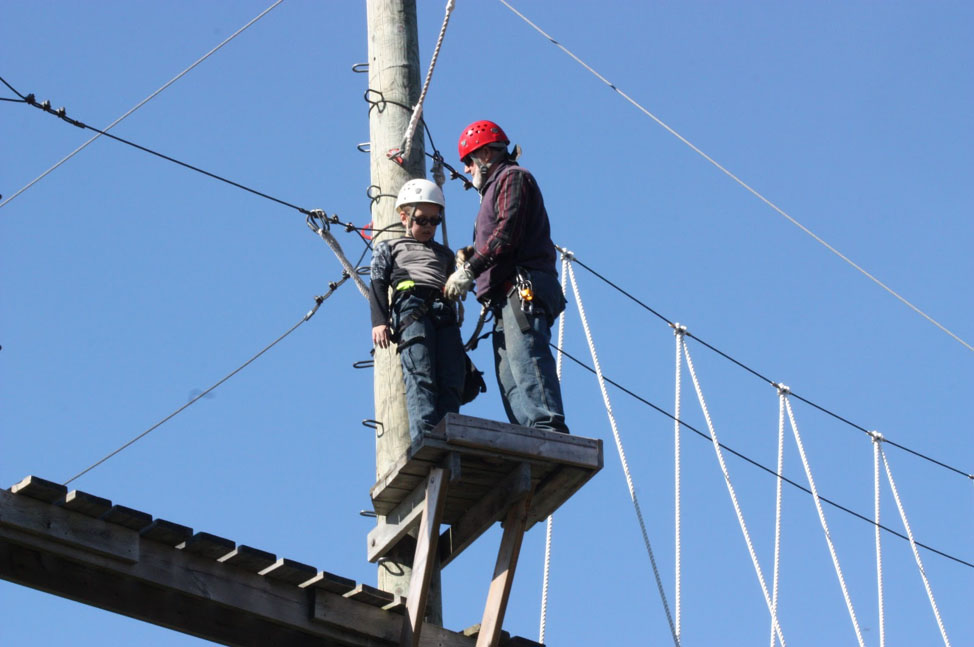Student with instructor on high platform