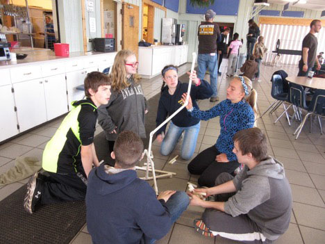 Students building project together