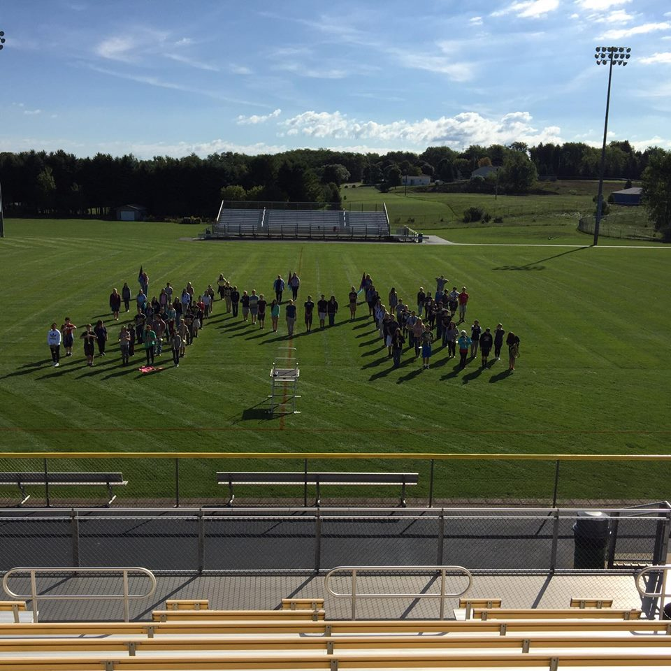 Band in M formation on football field