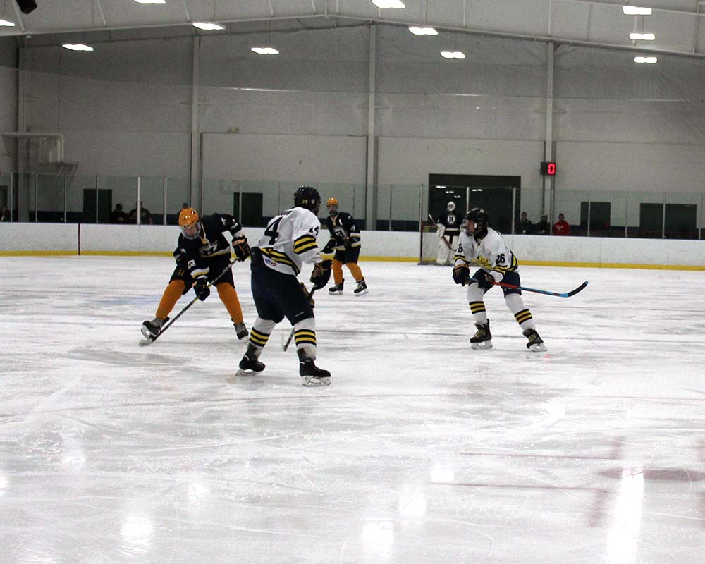 Manistee Chippewas Hockey team on ice playing game