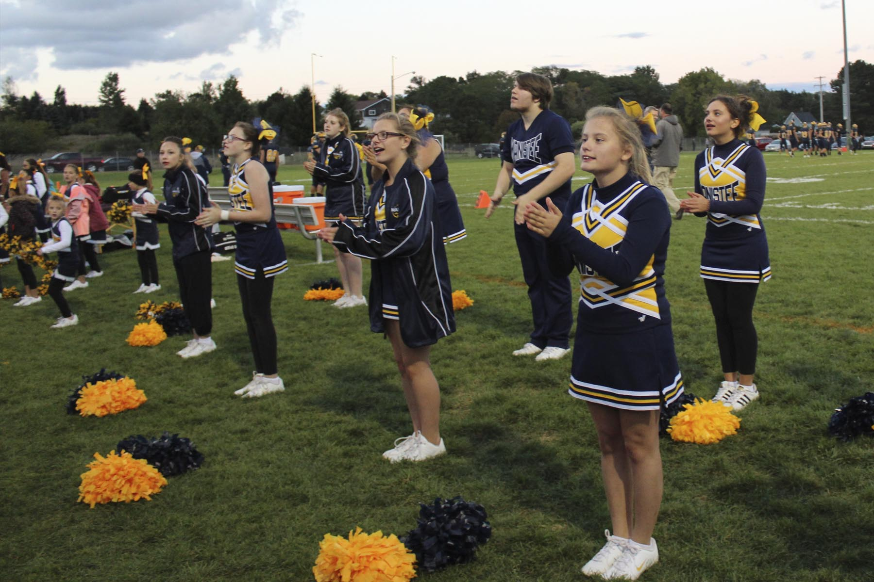 MMHS students cheering at High School football game