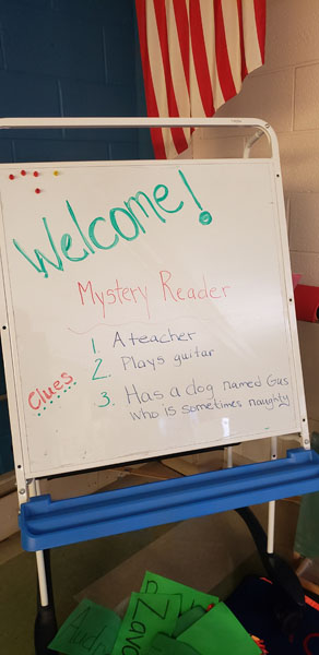 Welcome Mystery Reader sign