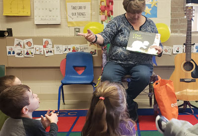 Mystery Reader reading to students