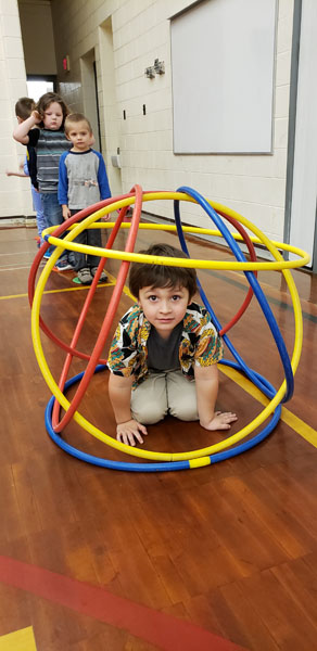 Student in hula hoop ball