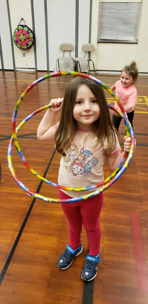 Student with two hula hoops