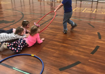 Students playing with hula hoops