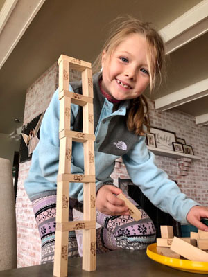 girl building tower