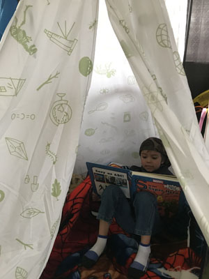 Boy in tent reading