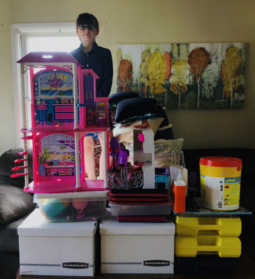 girl on top of toy tower