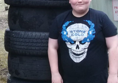 Boy next to tire tower