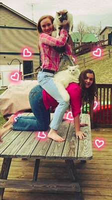 Girls making tower with cats