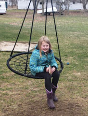 Girl on swing with book