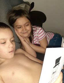 Brother and sister reading together