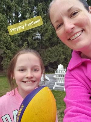 Mother and daughter playing football