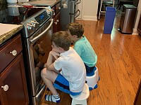 Boys waiting for cookies to bake