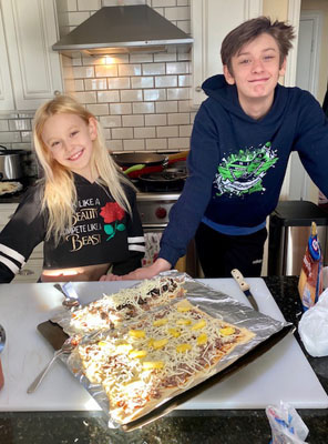 Brother and sister making pizza