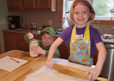 Boy and girl cooking