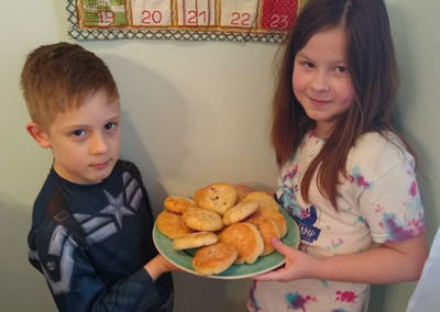Brother and sister holding plate of cakes