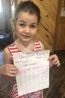 Girl holding paper chart of race