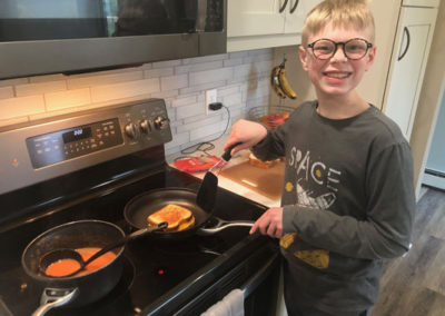 Boy making grilled cheese