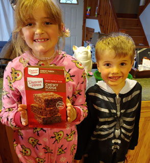 Sister and brother holding brownie box