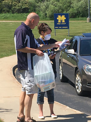 Principals helping with item pick up