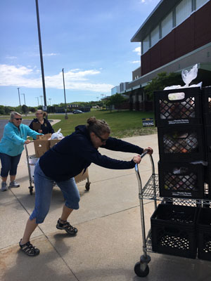 Food service workers preparing for food distribution